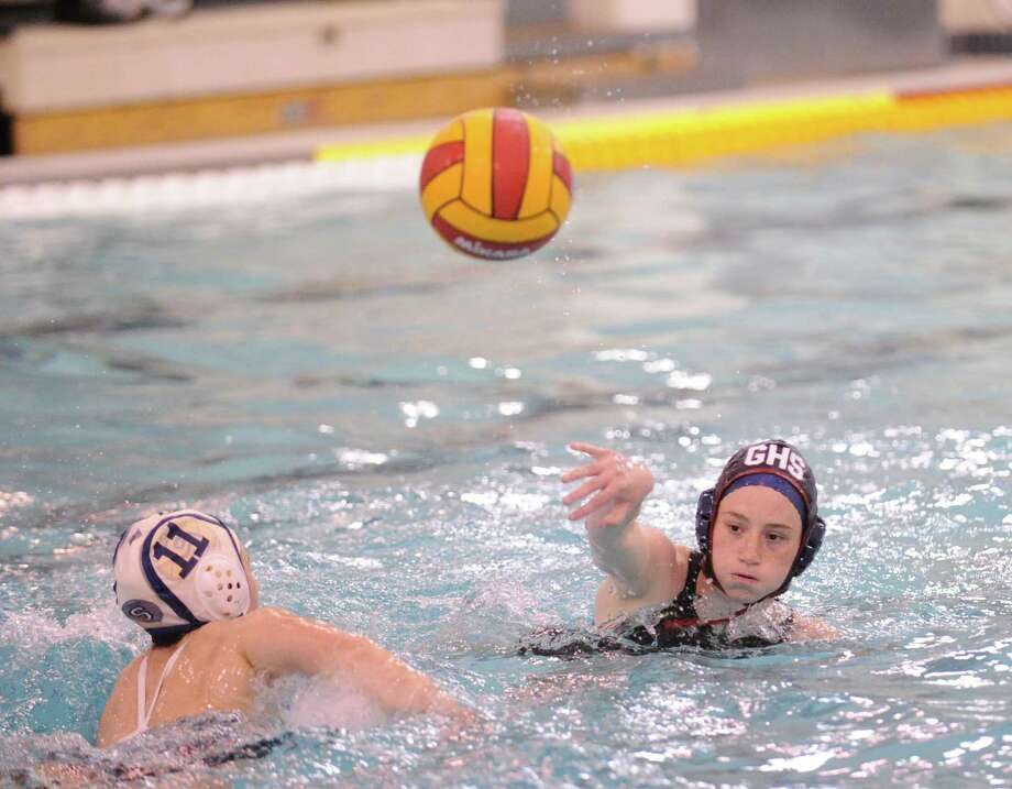 At right, Cliare Baxter of Greenwich shoots during the water polo match between Greenwich High School and Staples High School at Greenwich, Tuesday, April 23, 2013. At left defending on the play is Stacy Kaneko of Staples. Photo: Bob Luckey / Greenwich Time