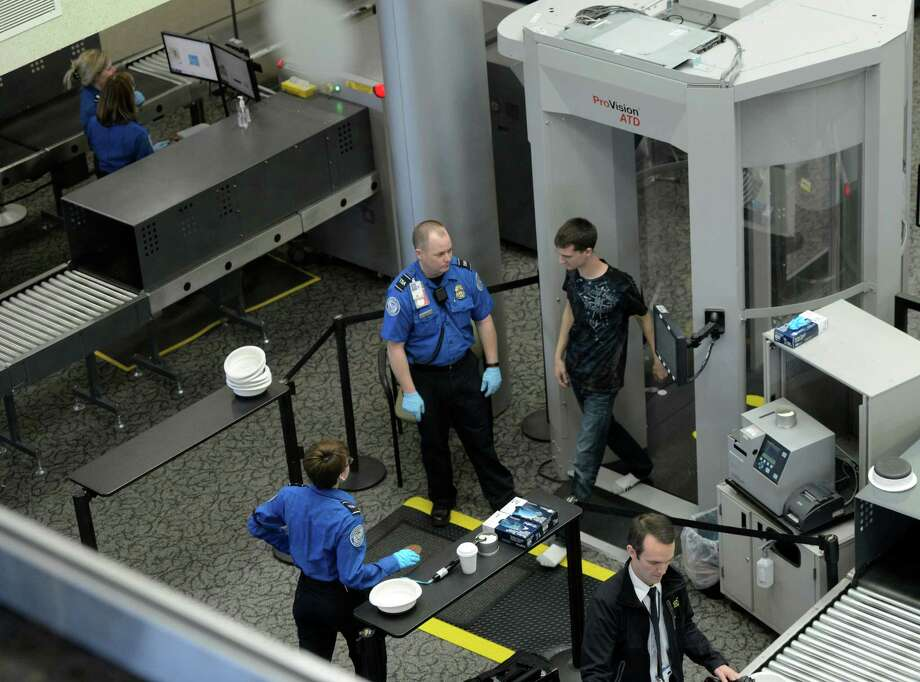 TSA workers do their security checks during a slow time at the Albany International Airport April 23, 2013 in Colonie, N.Y.    (Skip Dickstein/Times Union) Photo: SKIP DICKSTEIN / 10022087A