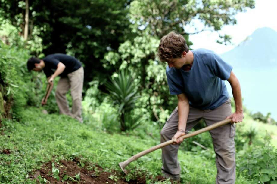 "In ""Living On One Dollar,\"" filmmakers Chris Temple, of Westport, and his classmate Zach Ingrasci work in the fields near the tiny village of Pena Blanca, Guatemala, where they subsist on a total of just $224 for an entire summer."
