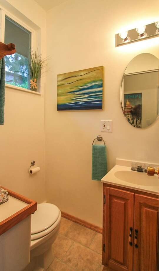 Bathroom of 13514 North Park Ave. N. The 1,490-square-foot home, built in 1955, has three bedrooms, two bathrooms, a slate entry, two fireplaces, a family room, exposed wood doors and moldings, French doors and a patio on a 5,929-square-foot lot with lakefront rights to a small private park. It's listed for $350,000, although a sale is pending. Photo: TCPeterson Photography, Courtesy Eva Brandenburg, Lake & Co. Real Estate