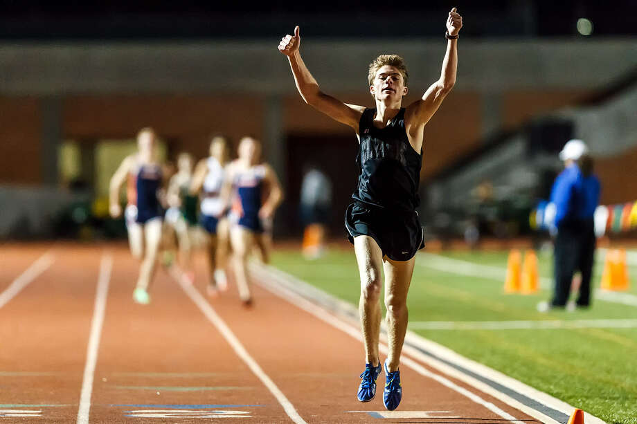Clark's Austin Wells celebrates as he crosses the finish line in the boys 1600-meter run during the area 25-5A/26-5A and 27-5A/28-5A track meet at Heroes Stadium on Friday. Clark won the event in the 27-5A/28-5A meet with a time of 4:21.93. Photo: Marvin Pfeiffer / Northwest Weekly