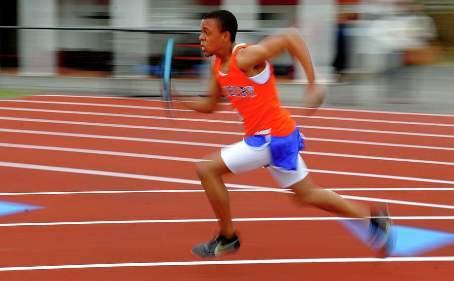 Danbury's Leo Abreu takes off at the start of the 4X100 relay race, during track meet action against Trumbull and Fairfield Warde in Fairfield, Conn. on Tuesday April 23, 2013. Photo: Christian Abraham / Connecticut Post