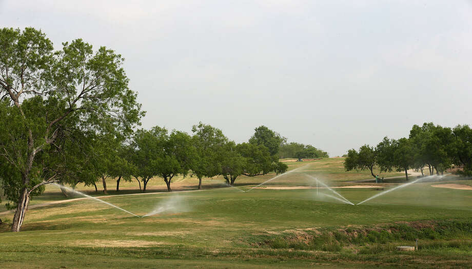 The 16th green at Mission Del Lago receives irrigation last week. On May 1, repairs to the course's watering system will start. Photo: Jerry Lara / San Antonio Express-News