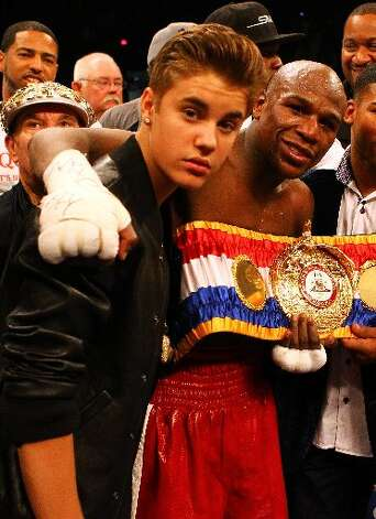 Justin Bieber and the champ Floyd Mayweather. Photo: Getty