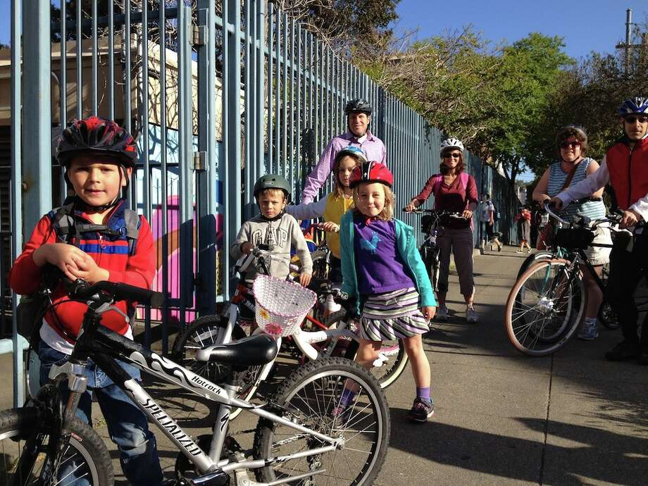 Left to Right: Kids: Cole Kanter, Will, Sophia, McKinley.    Parents: Will\'s father, Tracey (McKinley\'s mom) Laura (Sophia\'s mom), Ari (Cole\'s dad).    Sophia and mom Laura trekked in from the Sunset, and during Monday\'s ride the pedals came off Laura\'s bike.  She bought a new bike that same day and said she loves her new ride.