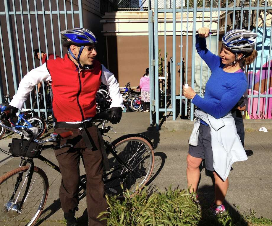 Peabody parents Ari Kanter and Sandra Miller chat after the 8:45 bell.  Ms. Miller, a former professional cyclist who rode for the Australian national team, is the coordinator for Peabody\'s Safe Routes to School program.
