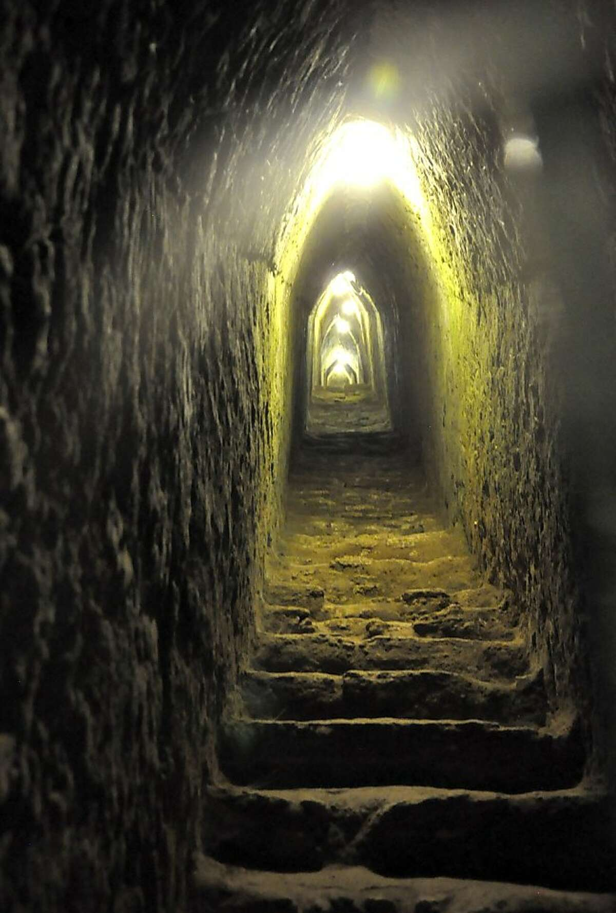 The Cholula Pyramid tunnel walk is a very different experience than climbing over Maya pyramids, which usually don't allow visitors into the chambers deep inside.
