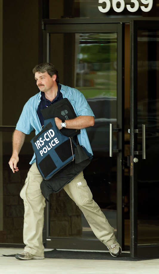 "Federal Investigators with the IRS and FBI combed the main headquarters for the Twin Liquors company on Airport Blvd Tuesday afternoon. Federal agents are at the Twin Liquors headquarters in North Austin conducting ""official business,"" spokesmen for the FBI and IRS told the American-Statesman. They declined to provide additional details. However, uniformed agents could be seen boxing items inside the building at 5639 Airport Blvd. The Texas Alcoholic Beverage Commission is also involved in the investigation, spokesman Dexter Jones said.