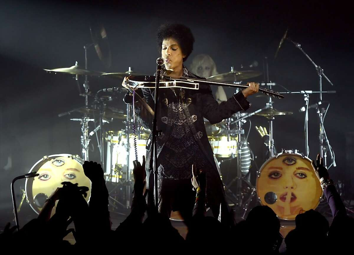 Prince and 3RDEYEGIRL perform at Vogue Theatre on April 15, 2013 in Vancouver, Canada.