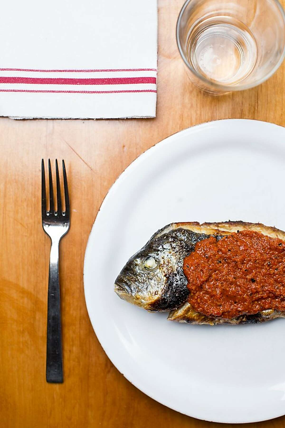 The wood-oven roasted whole dorade with romesco sauce.