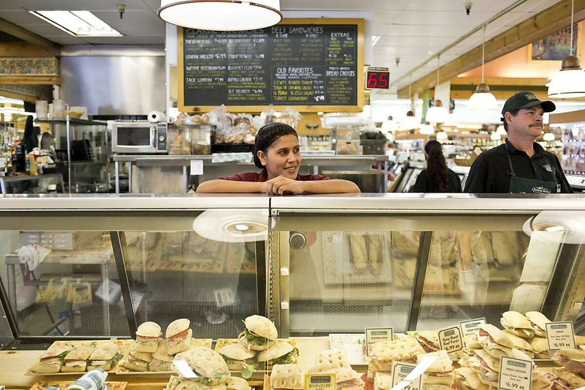 Ana Corona helps a customer with an order at Glen Ellen Village Market, which offers sandwiches with such names as the Jack London and Call of the Wild.