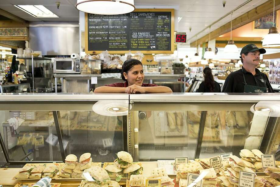 Ana Corona helps a customer with an order at Glen Ellen Village Market, which offers sandwiches with such names as the Jack London and Call of the Wild. Photo: Jason Henry, Special To The Chronicle