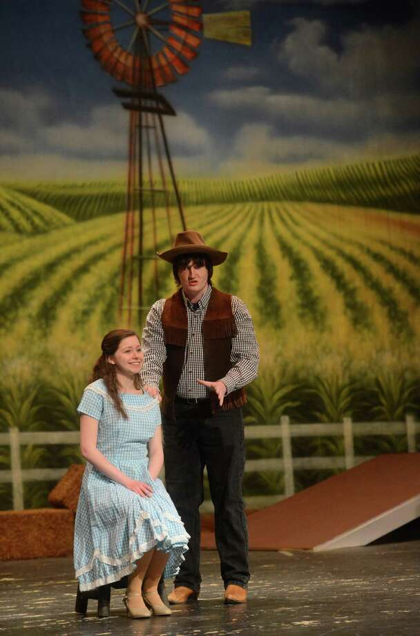 "Jessica Schwartz, playing Laurey Williams, and Dan McLoone, playing Curly McLain, perform at the dress rehearsal of ""Oklahoma!"" at Brookfield High School in Brookfield, Conn., on Tuesday, April 23, 2013.  The musical performances will be Friday at 7 p.m., Saturday at 2 and 7:30 p.m., and Sunday at 2 p.m. Photo: Tyler Sizemore / The News-Times"