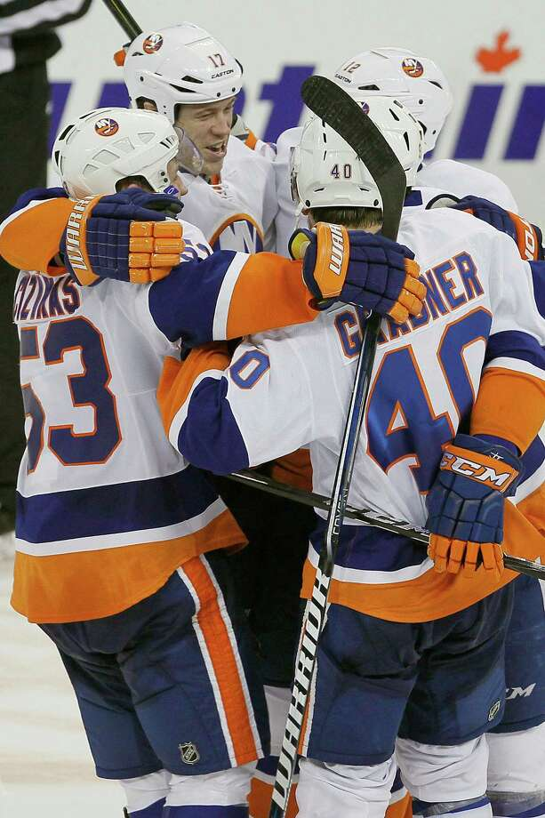 New York Islanders' Casey Cizikas (53), Matt Martin (17), Josh Bailey (12) and Michael Grabner (40) celebrate a shootout win over the Winnipeg Jets in an NHL hockey game in Winnipeg, Manitoba, Saturday, April 20, 2013. Cizikas played part of the season with the Sound Tigers. (AP Photo/The Canadian Press, John Woods) Photo: John Woods, Associated Press / The Canadian Press