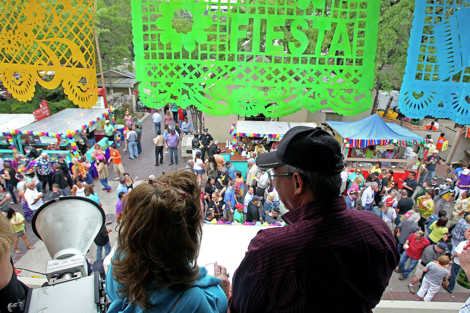 Sharon and George Antu watch the crowds from a balcony as NIOSA begins its's 2013 run at La Villita on  April 23 2013. Photo: TOM REEL