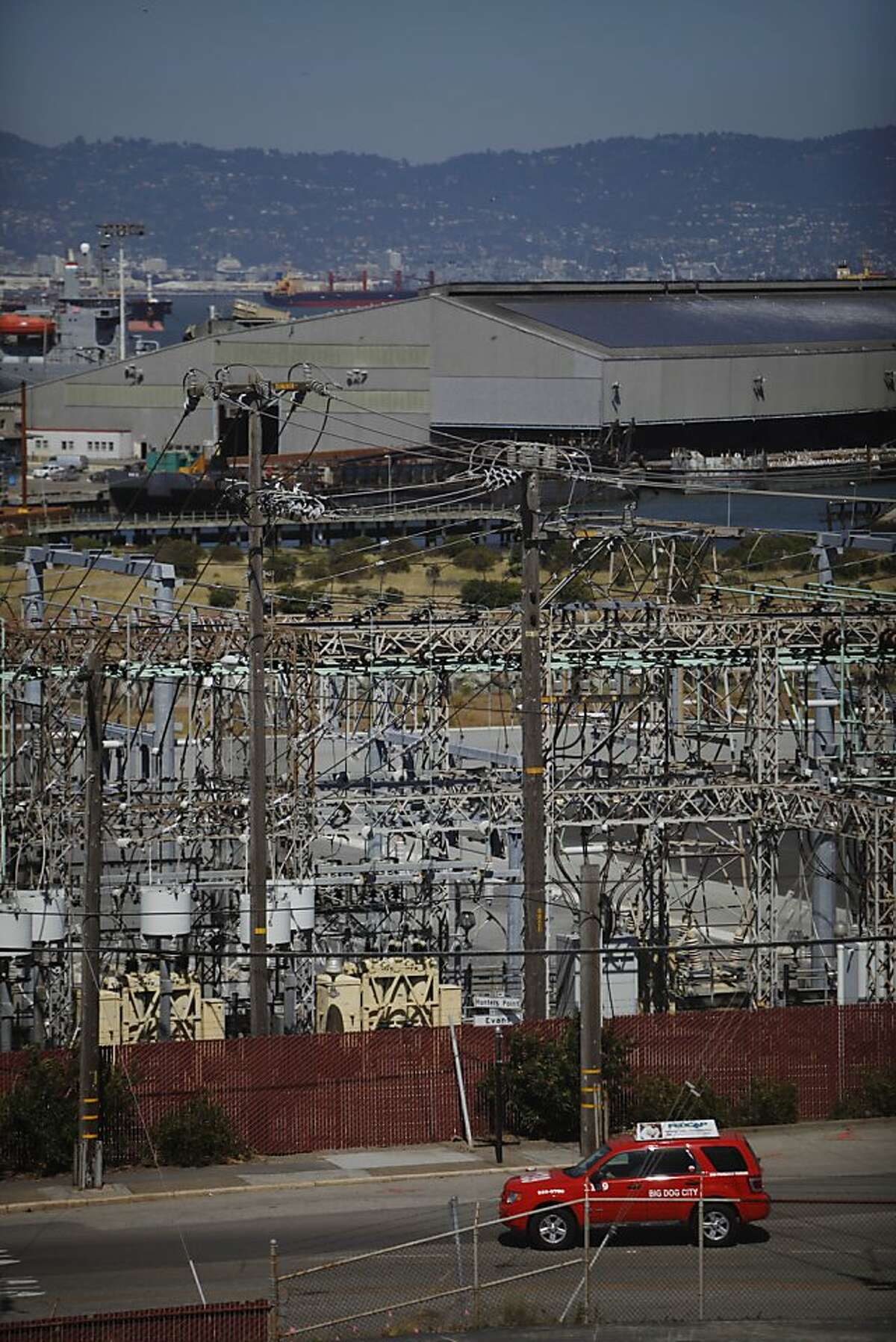 A car moves along Evans Avenue next to PG&E Hunter's Point Power Plant at 1000 Evans Avenue on Tuesday, April 23 2013 in San Francisco, Calif.