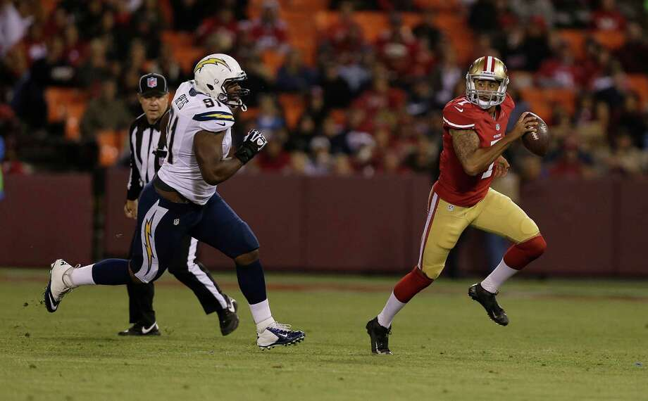 San Francisco 49ers quarterback Colin Kaepernick (7) scrambles from San Diego Chargers defensive end Kendall Reyes (91) during the first half of an NFL preseason football game in San Francisco, Thursday, Aug. 30, 2012. (AP Photo/Marcio Jose Sanchez) Photo: Marcio Jose Sanchez, Associated Press / AP