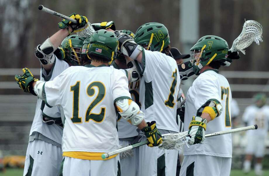 Siena players celebrate after scoring a goal during their men's college lacrosse game against UAlbany on Tuesday April 23, 2013 in Loudonville, N.Y.(Michael P. Farrell/Times Union) Photo: Michael P. Farrell