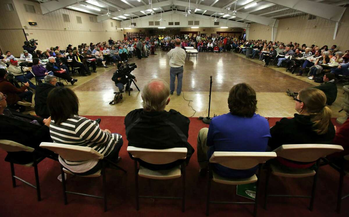 West Mayor Tommy Muska, center, takes questions at a town hall meeting held at the Knights of Columbus Hall for residents of West, TX, affected by the recent blast, on Tuesday April 23, 2013.