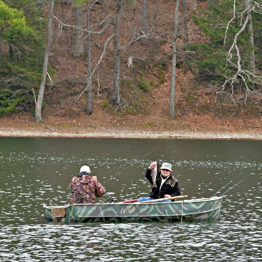 Ed Wait, at right, of Rock City Falls holds up a nice size rainbow trout as he and his fishing partner Dan Lessard of Ballston Spa work toward catching their limit at  Moreau Lake State Park in Moreau, NY Tuesday April 23, 2013.  (John Carl D'Annibale / Times Union) Photo: John Carl D'Annibale / 10022091A