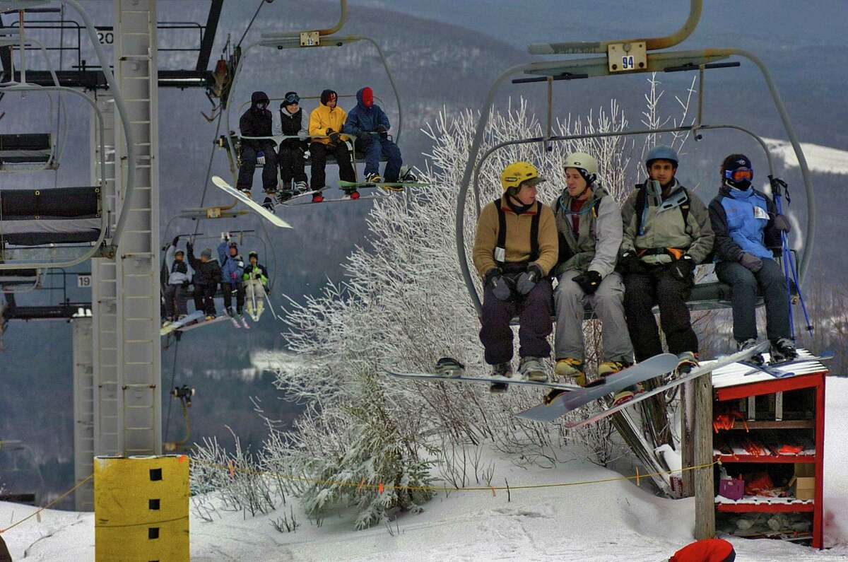 Skiers at Hunter Mountain ride the Quad lift, Monday January 2, 2006, during a busy day of skiing and snowboarding at the facility in Hunter, N.Y. (Philip Kamrass/Times Union archive)