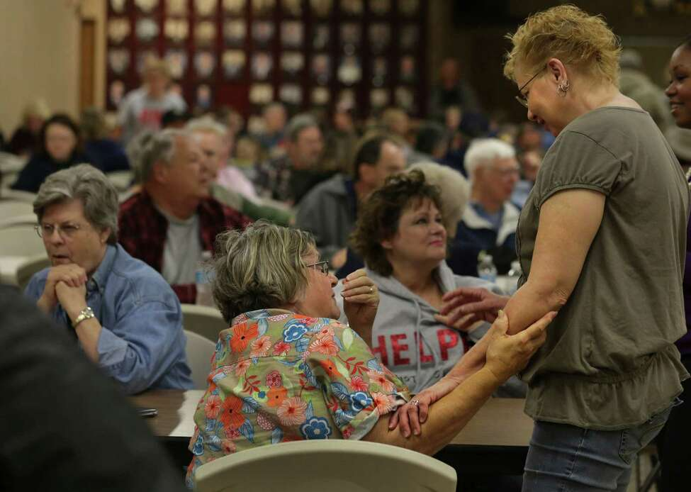 Jeanette Holecek, center, and Katherine Vrba, right, console each other as they share their stories of the explosion in West, TX, during a town hall meeting held at the Knights of Columbus Hall for residents affected by the recent blast, on Tuesday April 23, 2013.