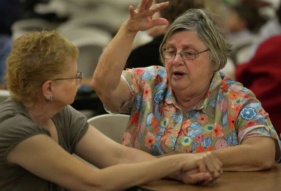 Jeanette Holecek, right, shares her stories of the explosion in West, TX with Katherine Vrba during a town hall meeting held at the Knights of Columbus Hall for residents affected by the recent blast, on Tuesday April 23, 2013. Photo: Bob Owen, San Antonio Express-News / ©2013 San Antonio Express-News