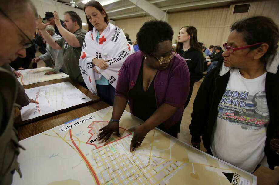 Residents of West, TX look at desaster map of their town, at a town hall meeting held at the Knights of Columbus Hall for residents of West, TX, affected by the recent blast, on Tuesday April 23, 2013. Photo: Bob Owen, San Antonio Express-News / ©2013 San Antonio Express-News