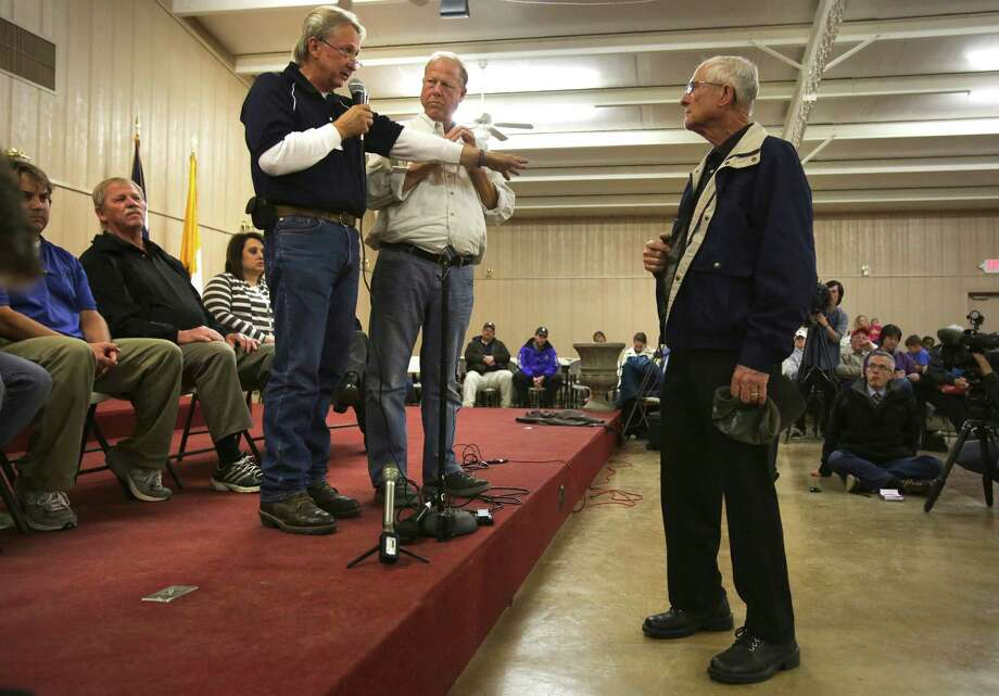West Mayor Tommy Muska, center, listens as Mayor Pro tem Steve Vanek, left, answers a question from a citizen at a town hall meeting held at the Knights of Columbus Hall for residents of West, TX, affected by the recent blast, on Tuesday April 23, 2013. Photo: Bob Owen, San Antonio Express-News / ©2013 San Antonio Express-News