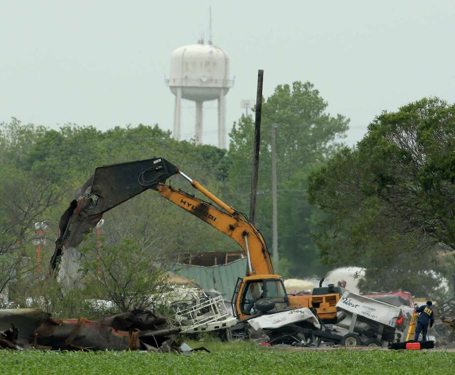 Heavy equipment is put to work Tuesday at the site of the fertilizer plant explosion in West, nearly a week after a massive blast at the local fertilizer plant killed 14 and forced many of the town's families from their homes. Photo: Charlie Riedel, STF / AP