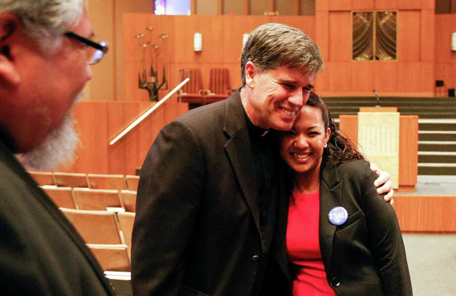 The Rev. Kevin Collins, pastor of Immaculate Conception Catholic Church, shows support for Gabriela Nieto and her dreams. Photo: Nick De La Torre, Staff / © 2013 Houston Chronicle