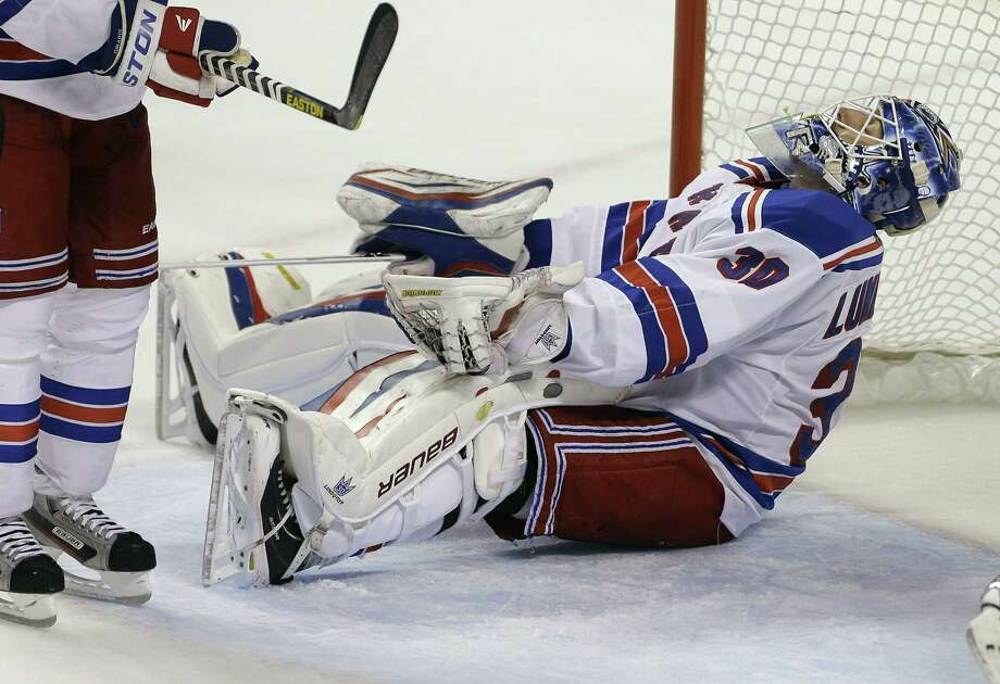 New York Rangers goalie Henrik Lundqvist reacts after allowing a goal by Florida Panthers' Filip Kuba during the second period of an NHL hockey game in Sunrise, Fla., Tuesday, April 23, 2013. (AP Photo/J Pat Carter) Photo: JPat Carter
