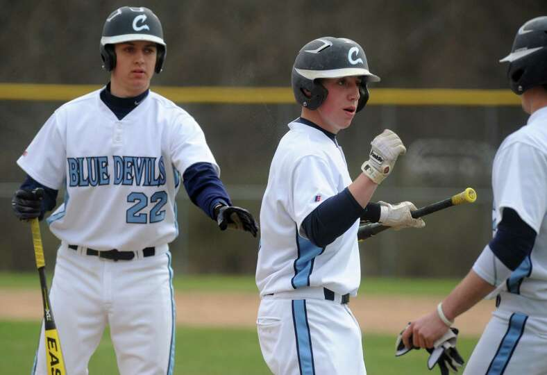 Columbia's Ryan Henchey is congratulated by teammates after crossing the plate during their high sch