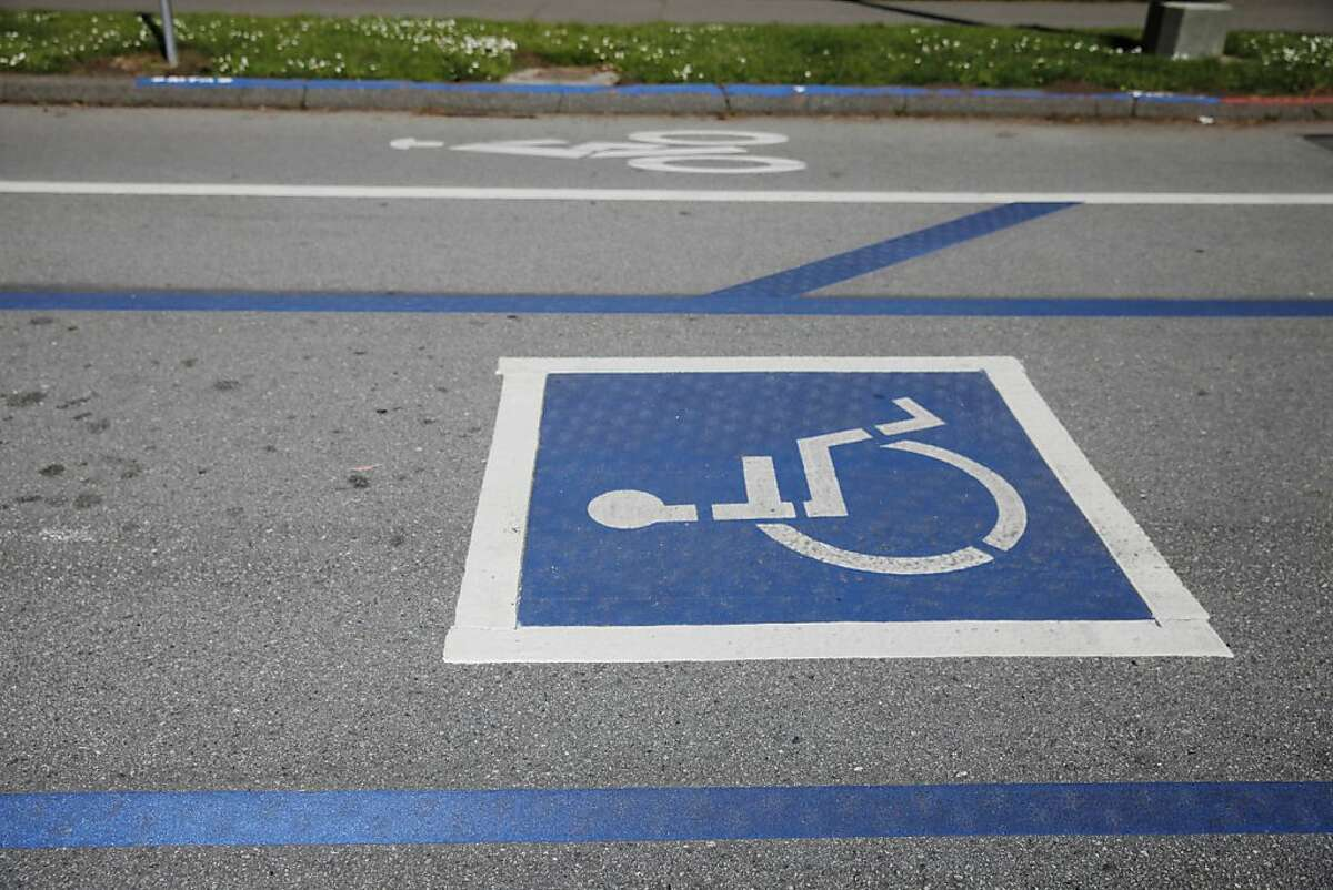A new handicapped parking space (bottom) is seen next to the old handicapped parking space (top, blue painted curb) along John F. Kennedy Drive in Golden Gate Park on Tuesday, April 23 2013 in San Francisco, Calif.