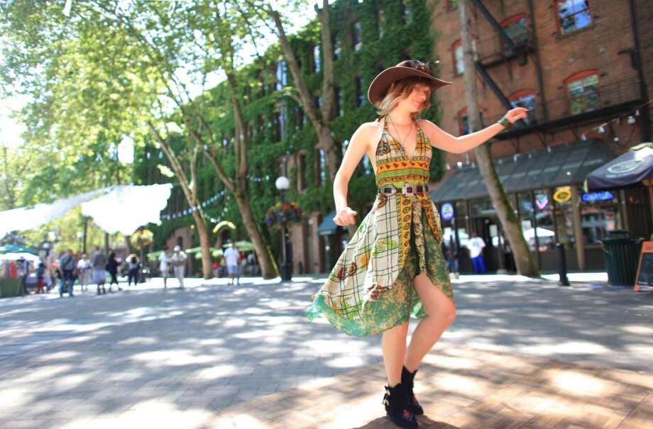The music downtown is pretty good and it's all a lot better in the sun. Shown here, Holly Thonton dances to music from a DJ in Pioneer Square