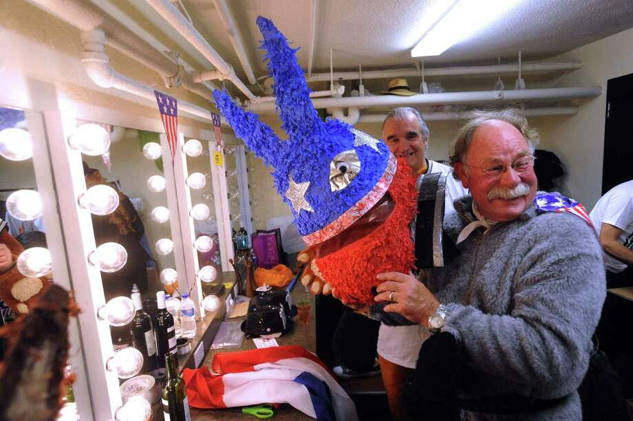 "Rod Logsdorn prepares backstage for his performance at Cornyation on Tuesday, April 23, 2013. Cornyation is an event that takes ""irreverent pokes at politicians, the prominent and not-so-prominent,"" according to its website. It benefits people living with AIDS or HIV. Photo: For The San Antonio Express-News / San Antonio Express-News"