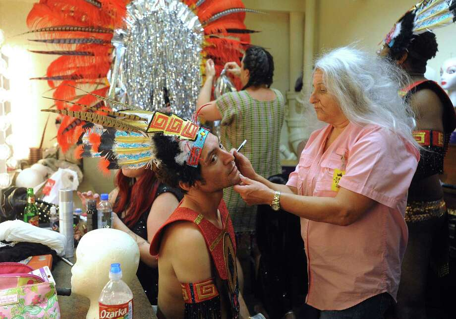 "Marcus Rosales, left, who plays the part of a Mayan, prepares for his role in Cornyation on Tuesday, April 23, 2013. Cornyation is an event that takes ""irreverent pokes at politicians, the prominent and not-so-prominent,"" according to its website. It benefits people living with AIDS or HIV. Photo: For The San Antonio Express-News / San Antonio Express-News"