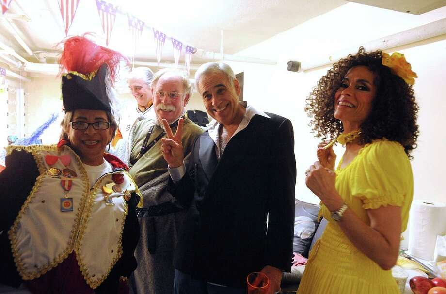 "Former Congressman Charlie Gonzalez and other cast members prepare backstage for Cornyation on Tuesday, April 23, 2013. Cornyation is an event that takes ""irreverent pokes at politicians, the prominent and not-so-prominent,"" according to its website. It benefits people living with AIDS or HIV. Photo: For The San Antonio Express-News / San Antonio Express-News"