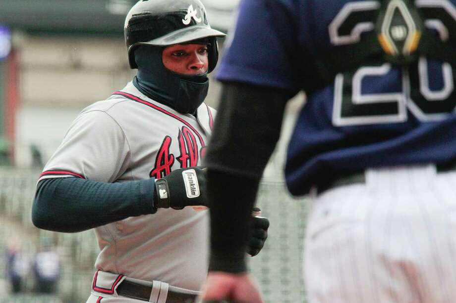 Even Denver's 23-degree weather couldn't cool off Justin Upton, who hit his 10th home run in the opener of a doubleheader and No. 11 in the nightcap. Photo: Barry Gutierrez, FRE / FR170088 AP