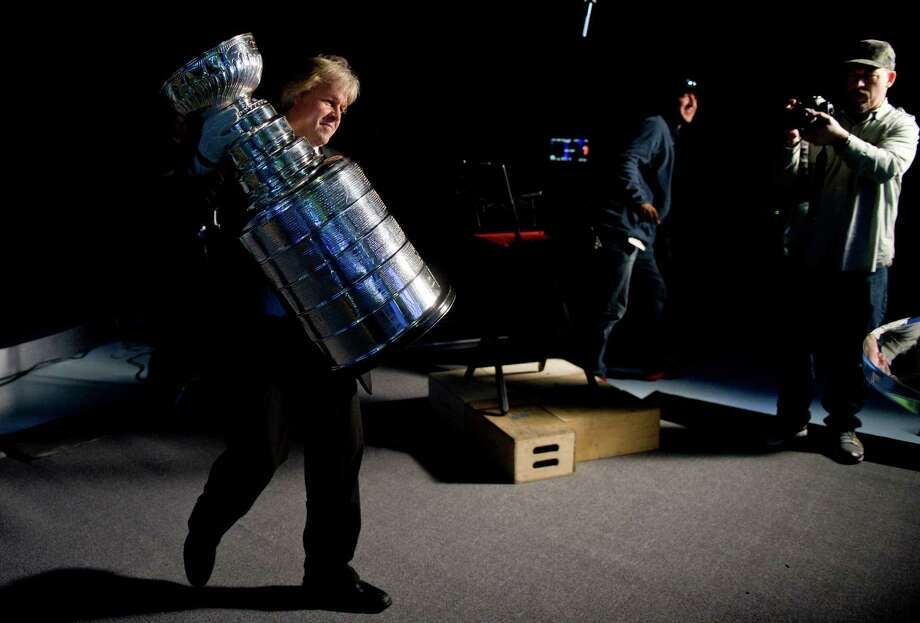 Philip Pritchard, Keeper of the Cup, sets up the Stanley Cup at NBC in Stamford, Conn., on Thursday, April 11, 2013. NBC has collected various sports trophies to promote their 2013 coverage. Photo: Lindsay Perry / Stamford Advocate