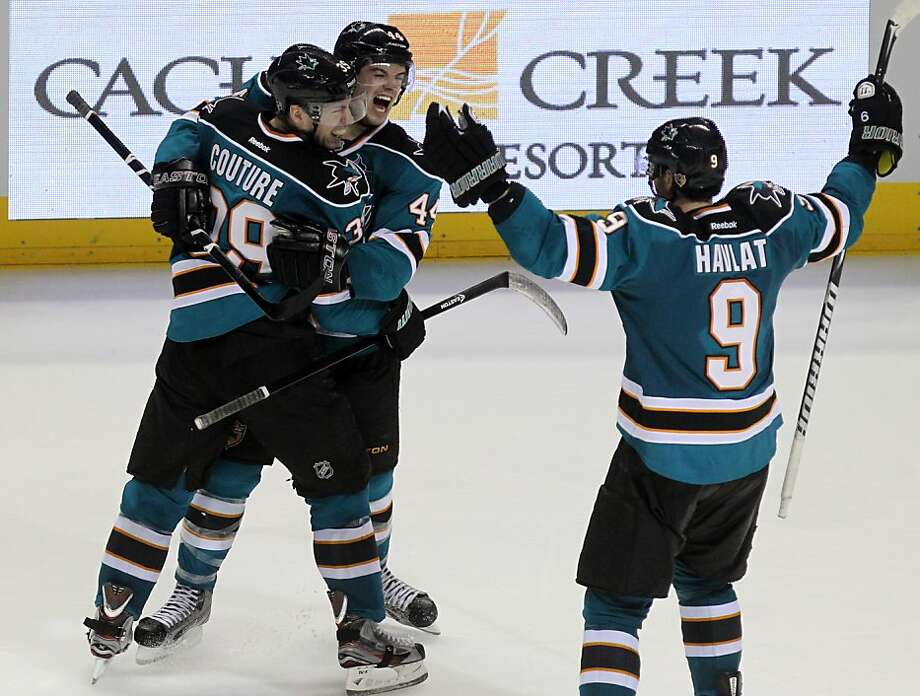 Logan Couture #39 of the San Jose Sharks celebrates his third period goal with teammates Marc-Edouard Vlasic #44 and Martin Havlat #9 during their NHL game with the Dallas Stars at HP Pavilion on Tuesday, April 23, 2013 in San Jose, California. Photo: Lance Iversen, The Chronicle