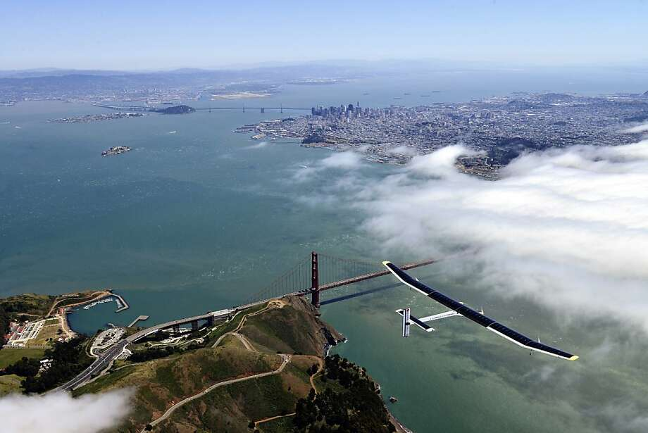 In this image provided by Solar Impulse, the sun-powered plane The Solar Impulse glides over the Golden Gate Bridge in San Francisco during a successful test flight on Tuesday, April 23, 2013. The solar-powered airplane is preparing for a journey around the world, scheduled to begin on May 1. The Solar Impulse is powered by about 12,000 photovoltaic cells that cover massive wings and charge its batteries, allowing it to fly day and night without jet fuel. It has the wing span of a commercial airplane but the weight of the average family car, making it vulnerable to bad weather. (AP Photo/Solar Impulse) Photo: Associated Press