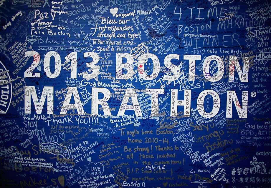 BOSTON, MA - APRIL 23:  Signatures adorn a Boston Marathon poster near the site of the Boston Marathon bombings on April 23, 2013 in Boston, Massachusetts. Business owners and residents of the closed section were allowed to return to their properties today while under escort of city staff.  (Photo by Mario Tama/Getty Images) Photo: Mario Tama, Getty Images