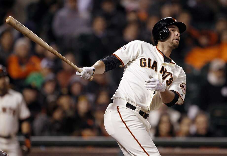 Brandon Belt watches the flight of his two run homerun in the bottom of the ninth that tied the game. The San Francisco Giants played the Arizona Diamondbacks at AT&T Park in San Francisco, Calif,. on Tuesday, April 23, 2013. Photo: Carlos Avila Gonzalez, The Chronicle