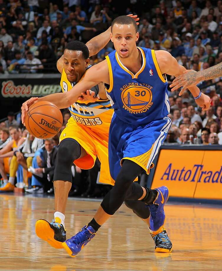 The Warriors' Stephen Curry, pursued by Andre Iguodala, had 30 points and 13 assists and made 13 of his 23 field goal tries. Photo: Doug Pensinger, Getty Images