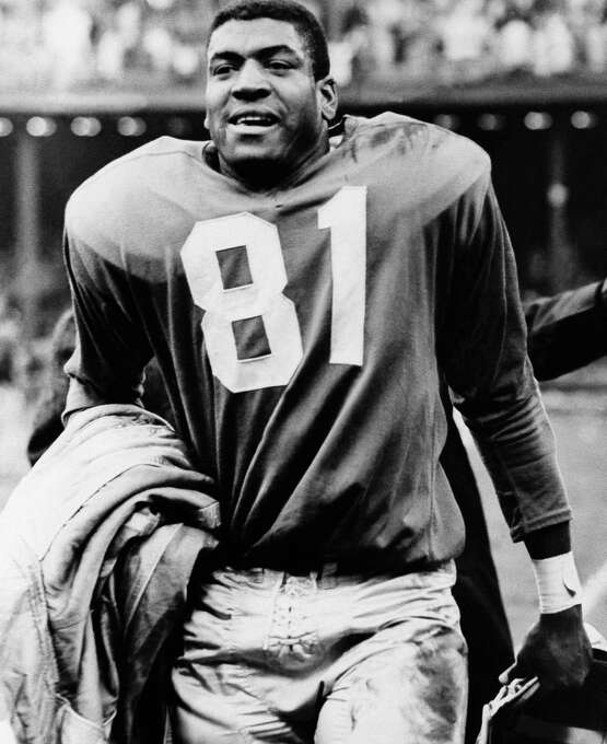 """Detroit Lions: DB Dick """"Night Train"""" Lane, Western Nebraska, CC-Scottsbluff. The 7-time Pro Bowler and 3-time All-Pro had 68 career INTs. He originally signed with the Los Angeles Rams and had 14 INTs as a rookie and tallied 10 more for the Chicago Cardinals in '54. Played his last 6 seasons for Lions.   PHOTO: Lane leaves the field at Briggs Stadium after intercepting a Johnny Unitas pass in closing minutes of game and racing 80 yards for a touchdown, Oct. 23, 1960, in Detroit. Photo: Preston Stroup, Associated Press File Photo / 1960 AP"""