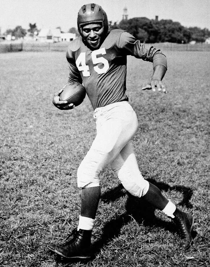 New York Giants: S Emlen Tunnell, Toledo, Iowa. The 9-time Pro Bowler and 4-time All-Pro collected 79 interceptions for Giants from 1947-55 and Packers from '59-61. In 1952 he gained more yards on kickoffs, punts and interceptions (924) than that season's NFL rushing leader. Elected to Hall of Fame in '67.   PHOTO: Tunnell is seen on April 2, 1949. Photo: Associated Press File Photo / AP1949