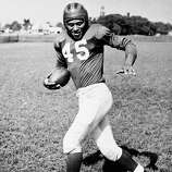 New York Giants: S Emlen Tunnell, Toledo, Iowa. The 9-time Pro Bowler and 4-time All-Pro collected 79 interceptions for Giants from 1947-55 and Packers from '59-61. In 1952 he gained more yards on kickoffs, punts and interceptions (924) than that season's NFL rushing leader. Elected to Hall of Fame in '67.   PHOTO: Tunnell is seen on April 2, 1949.