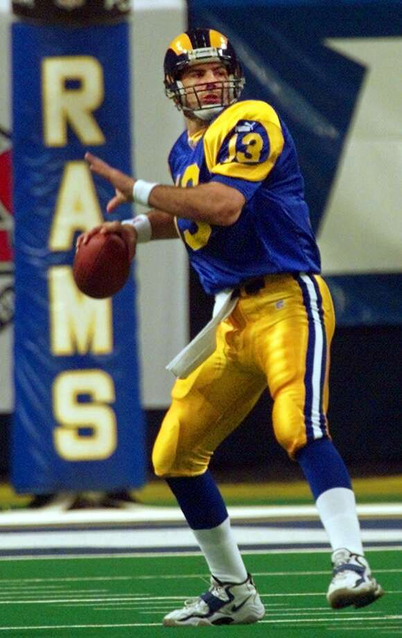 St. Louis Rams: Kurt Warner, QB, Northern Iowa. Originally signed by the Packers, where he had no shot of beating out Brett Favre. He played in the Arena League before becoming a 2-time MVP and a Super Bowl MVP for the Rams. He also led the Arizona Cardinals to a Super Bowl, capping a 12-year career that included 4 Pro Bowl berths and 2 All-Pro selections.   PHOTO: Warner sets to throw a 77-yard touchdown pass to receiver Isaac Bruce during the first quarter of the NFC divisional playoff game against the Minnesota Vikings on Jan. 16, 2000, at the Trans World Dome in St. Louis. Photo: J. Pat Carter, Associated Press File Photo / 2000 AP
