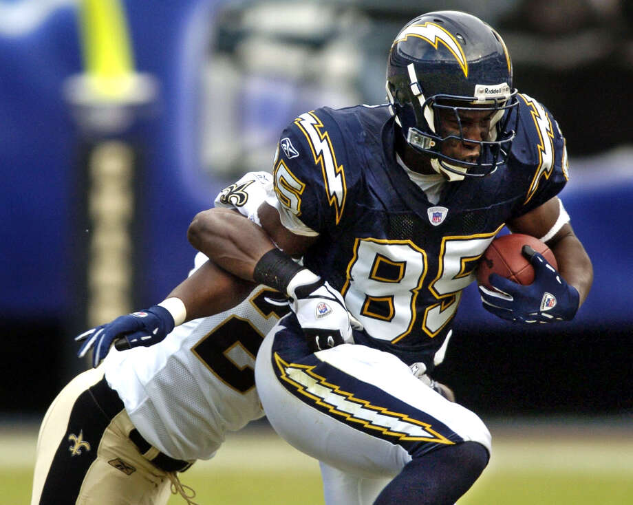 San Diego Chargers: TE Antonio Gates, Kent State. Was a power forward as a college basketball player and didn't play football until signing with the Chargers in 2003. One of the best tight ends in NFL history, he has 83 career TD catches and is an 8-time Pro Bowler and 3-time All-Pro.   PHOTO: Gates drags a New Orleans Saints defender after a reception on Nov. 7, 2004, in San Diego. Photo: Lenny Ignelzi, Associated Press File Photo / 2004 AP
